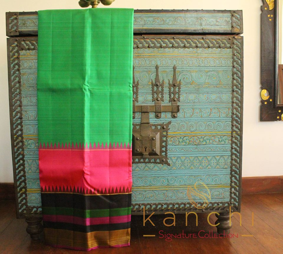 green kanchipuram saree with wide border