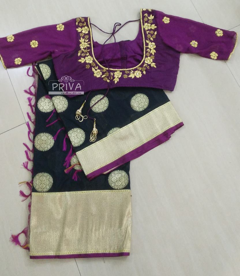 Black banaras saree with designer magenta blouse