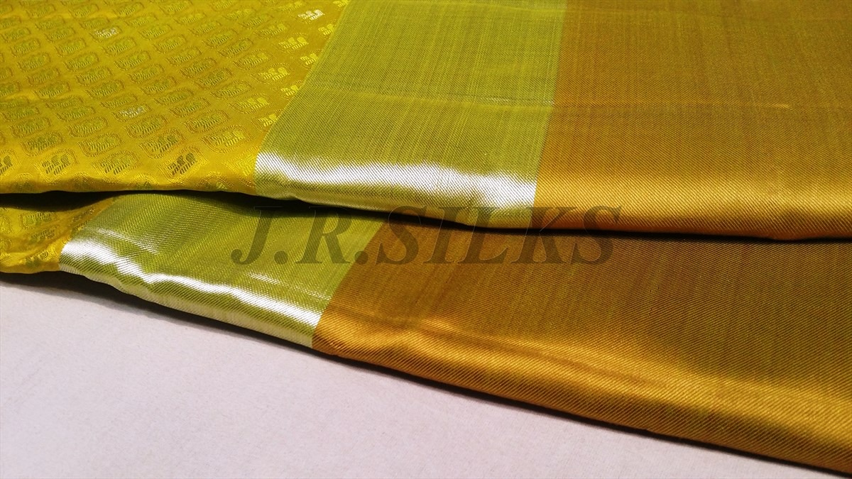 mustard yellow kanjivaram saree with kaddi border