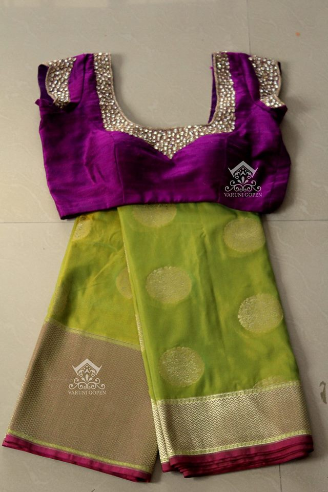 olive green benaras saree with violet designer blouse from varuni gopen collections