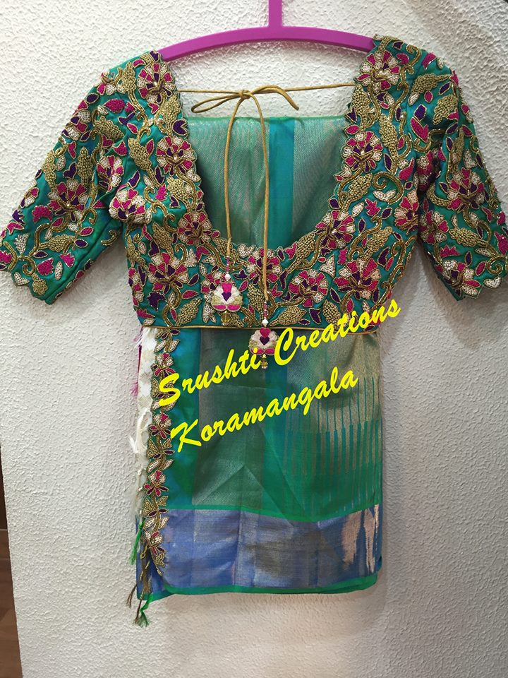 sea green kanjivaram saree with designer blouse