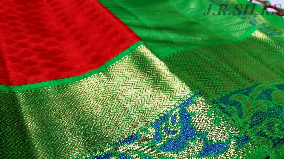 tomato red kanjivaram saree with green border